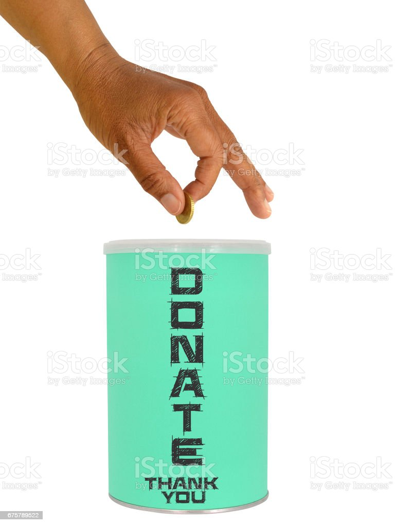 Hand Dropping Coin Donation Can stock photo