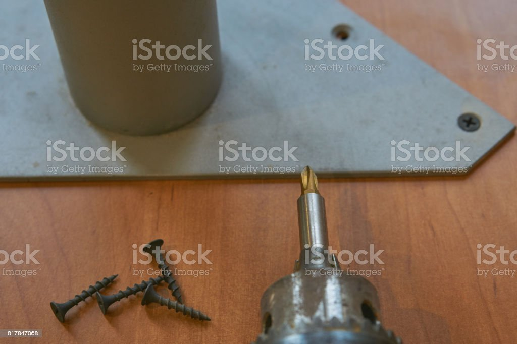 hand electric screwdriver with screws stock photo