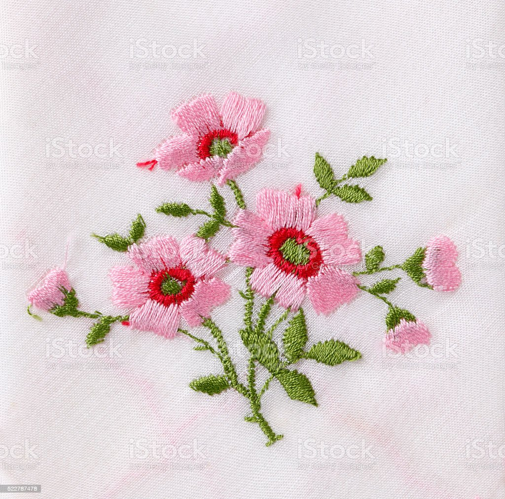 Hand embroidered flower stock photo