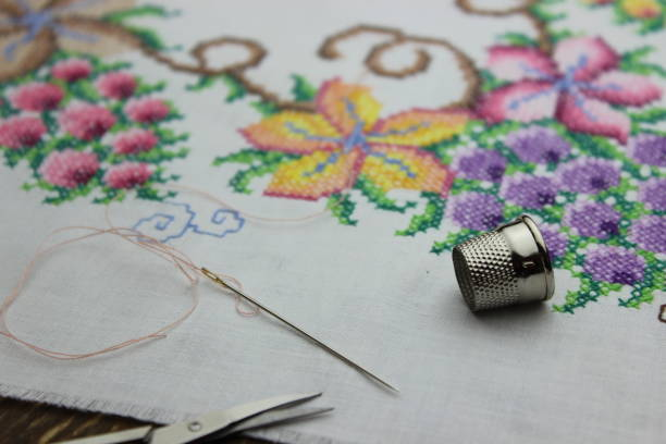 hand embroidery with needle and scissors - embroidery machine stock pictures, royalty-free photos & images