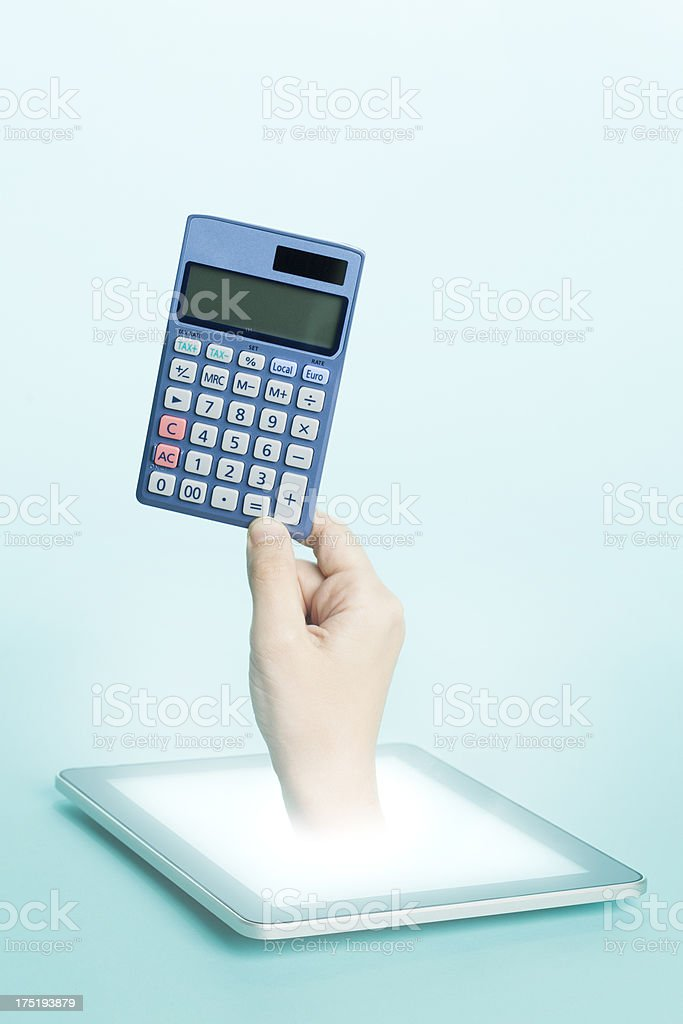 Hand emerging from tablet screen holding a calculator royalty-free stock photo