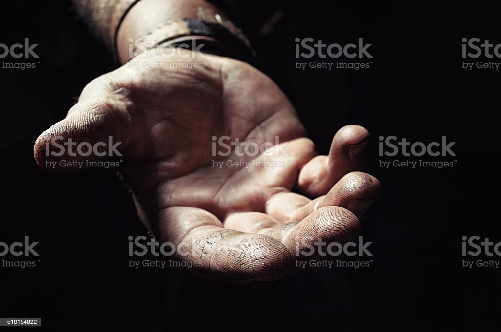 Hand emerging from the dark stock photo