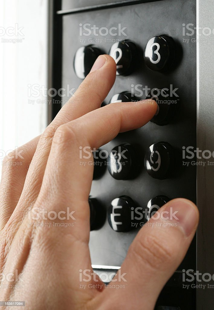 hand entering a code into the keypad royalty-free stock photo