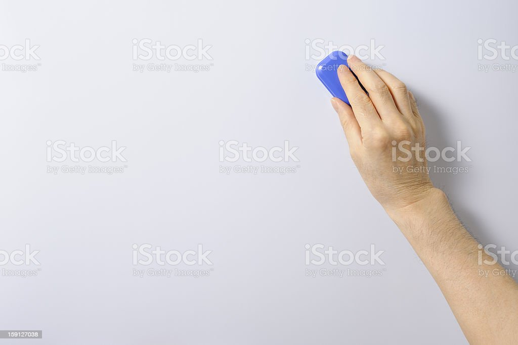 Hand erasing the letter of the whiteboard stock photo