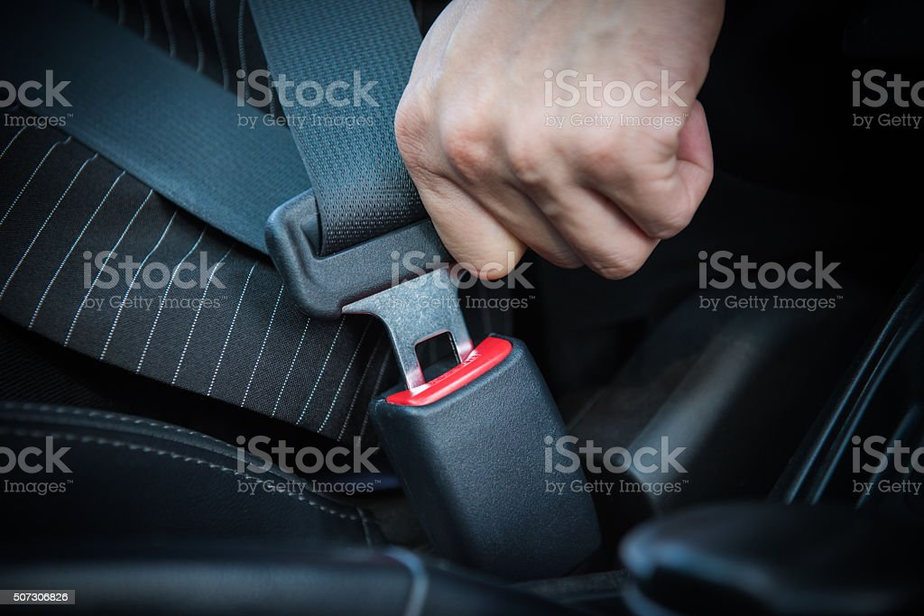 Hand fastening seat belt stock photo