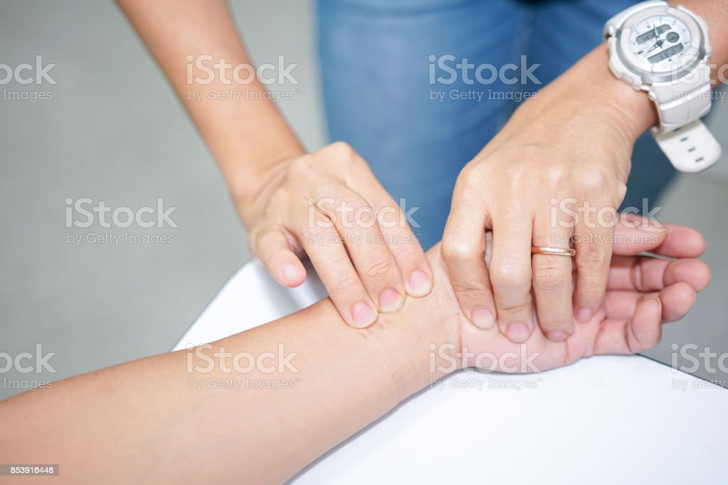 Hand feel for the pulse of the people who are unconscious. Radial Pulse Assessment. stock photo