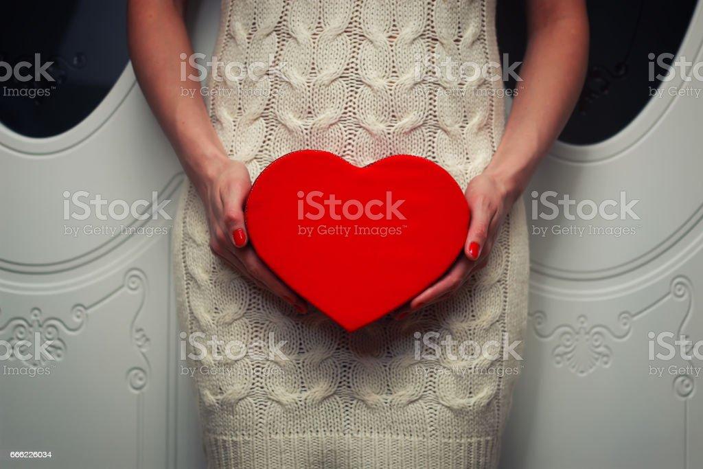 Hand female holding heart stock photo