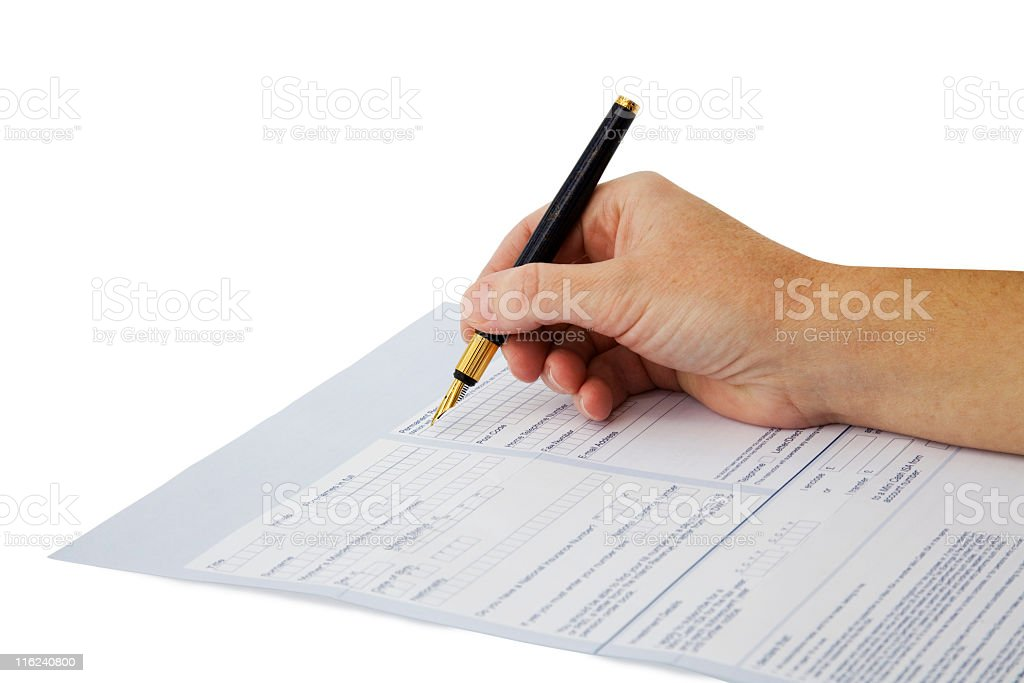 Hand filling a form with a pencil royalty-free stock photo