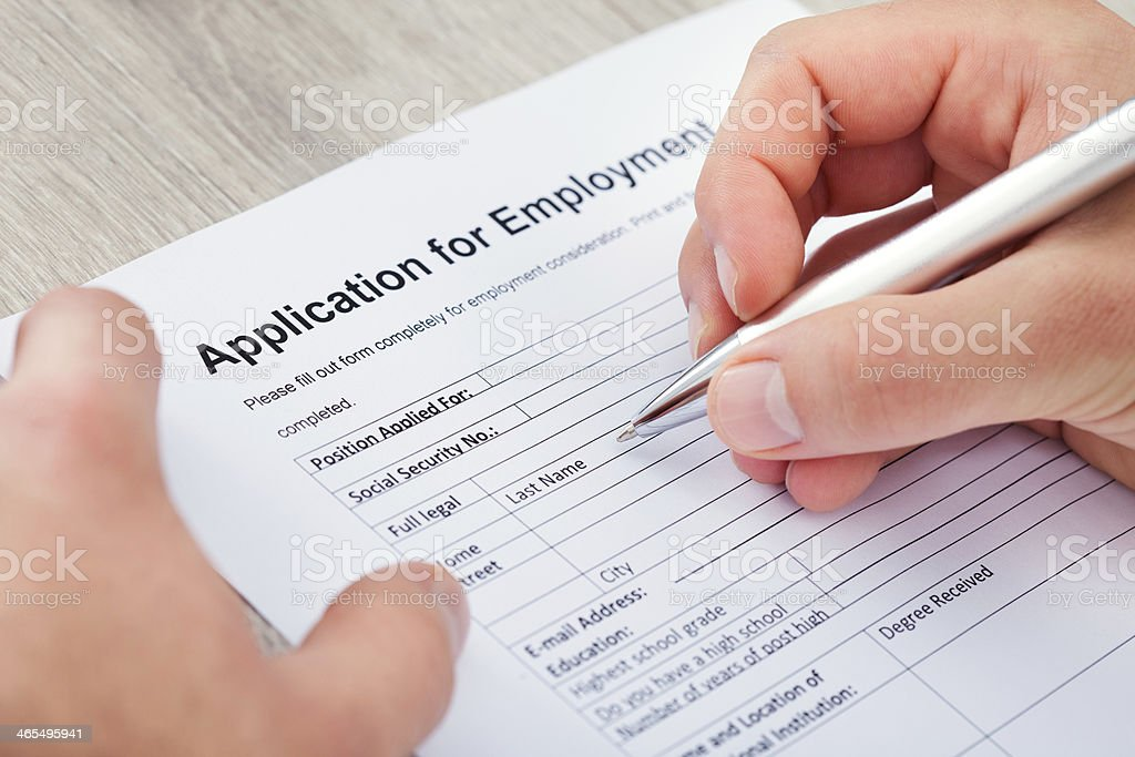 Hand Filling Application For Employment stock photo