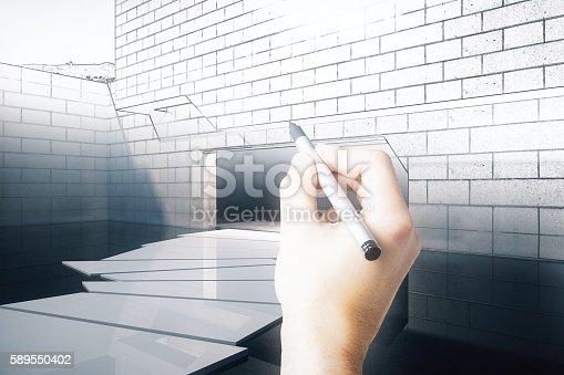 istock Hand finishing exterior blueprint 589550402