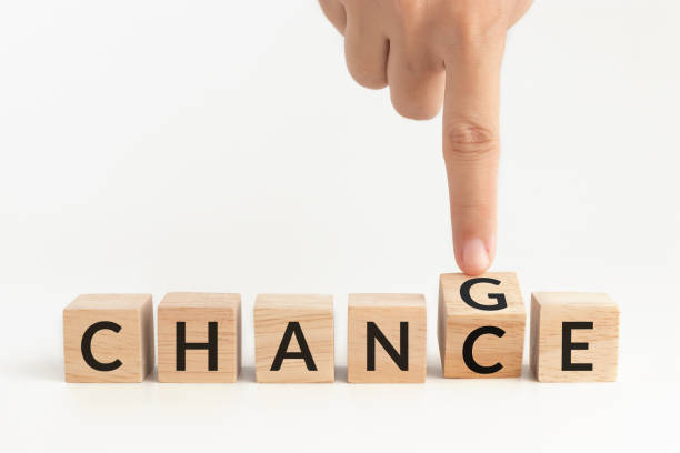 hand flip wooden cube with word change to chance. self improvement, personal development for skills and qualities and career growth or change yourself concept - new normal foto e immagini stock