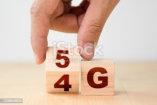 istock Hand flipping wooden cubes for change