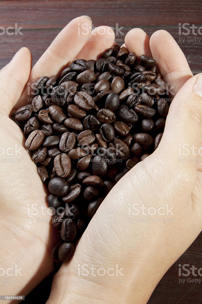 hand full of coffee bean royalty-free stock photo
