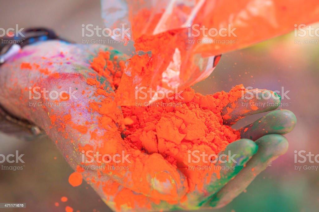 Hand Full of Dye at Holi Festival stock photo
