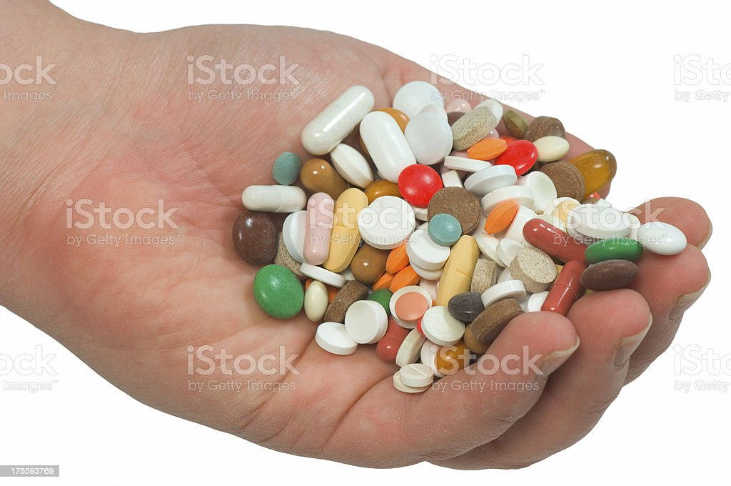 hand full of pills royalty-free stock photo