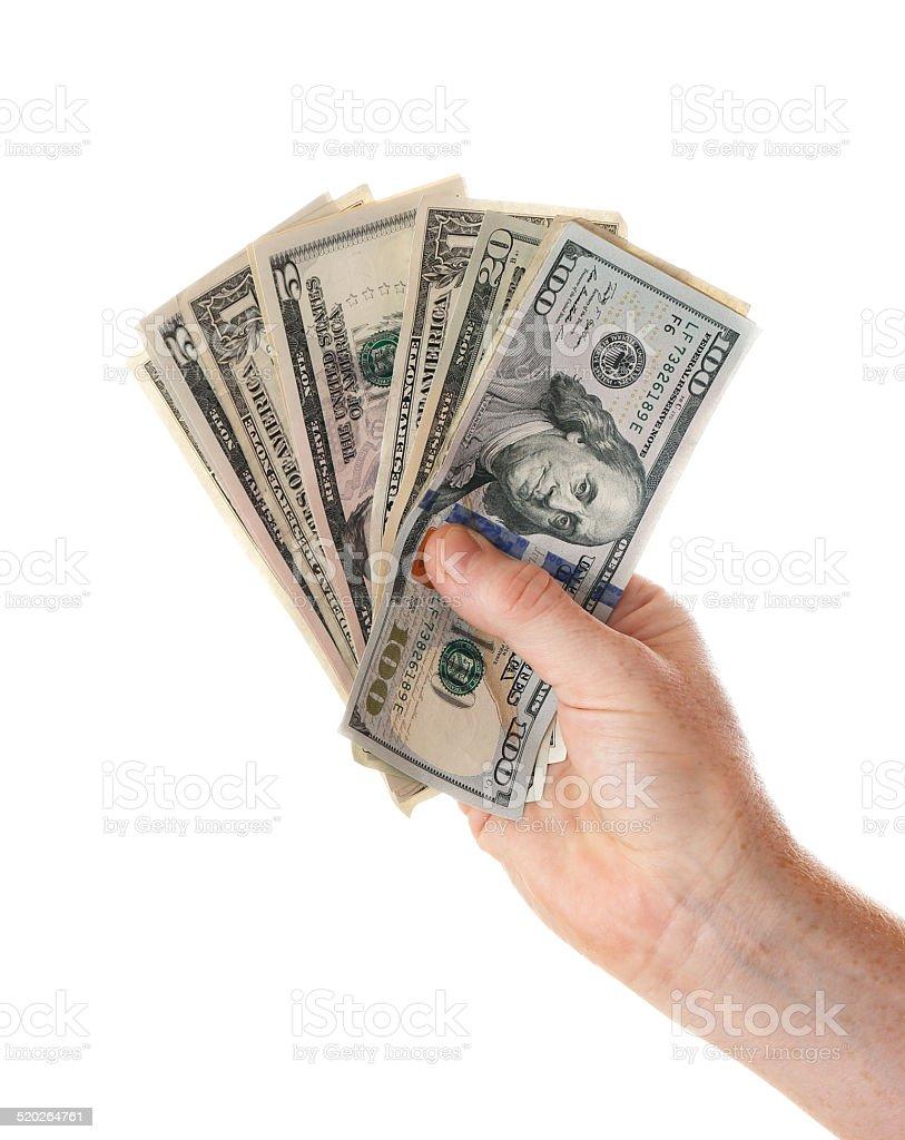 Hand full of US dollars stock photo