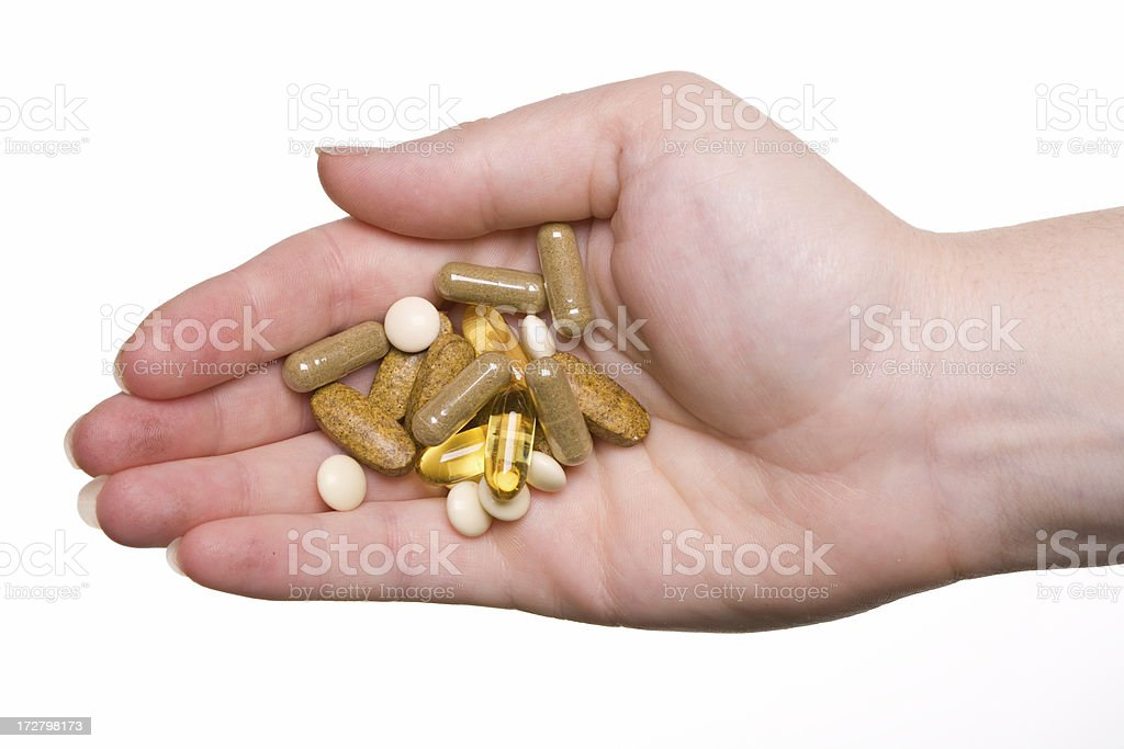 hand full of vitamins royalty-free stock photo