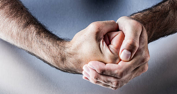 hand gesture for symbol of courage, power, union or impatience - fist stock photos and pictures