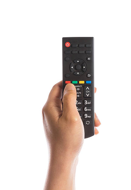 hand gesture hand holding remote control isolated on white background remote control stock pictures, royalty-free photos & images