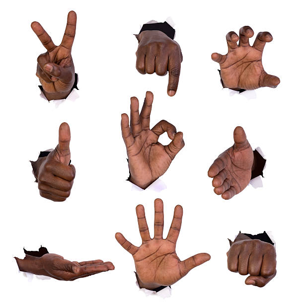 Hand gestures through holes in paper stock photo