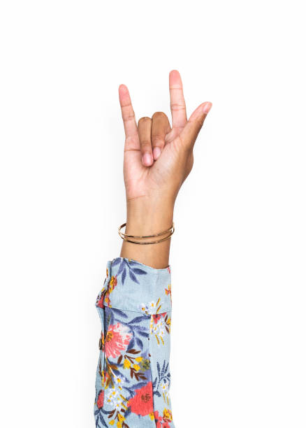Hand gesturing the i love you hand sign stock photo