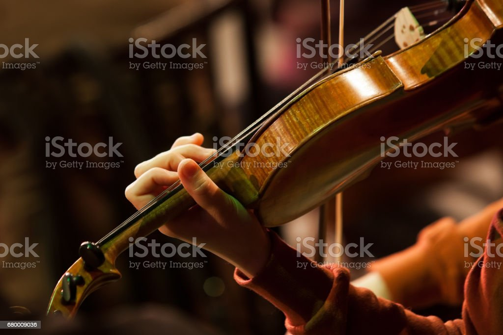 Hand girl on the strings violin stock photo