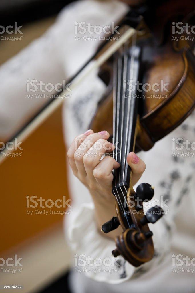 Hand girl playing the violin stock photo