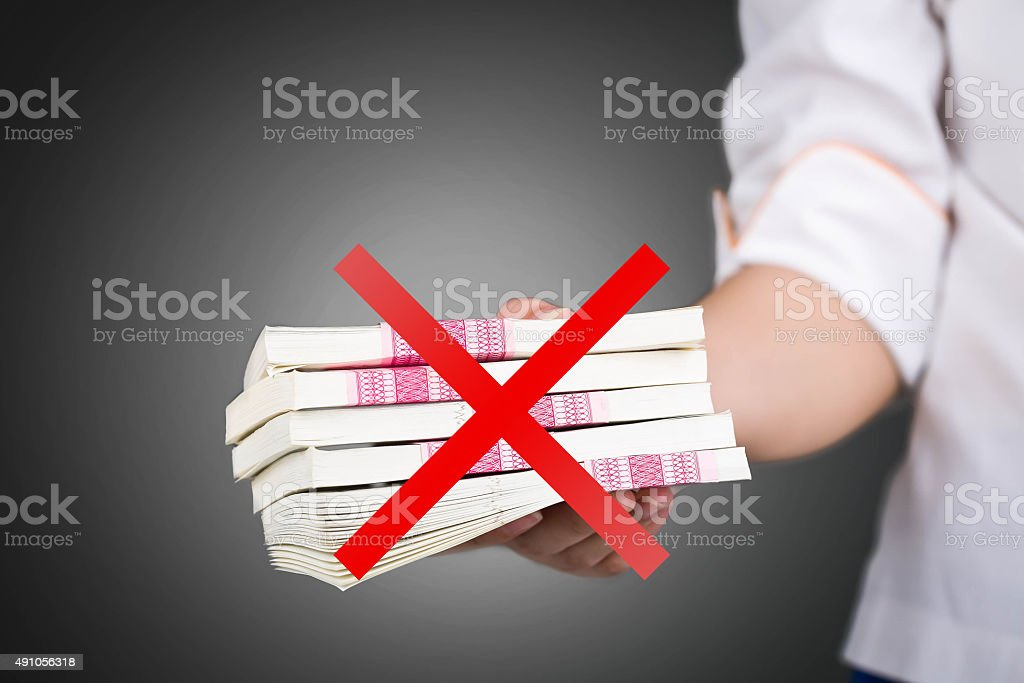 Hand give dirty money pack corruption, not taking. stock photo