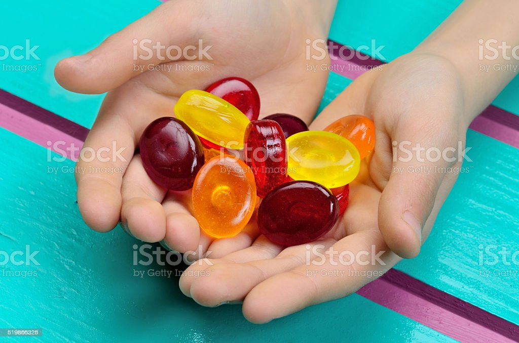 hand give you bonbons stock photo