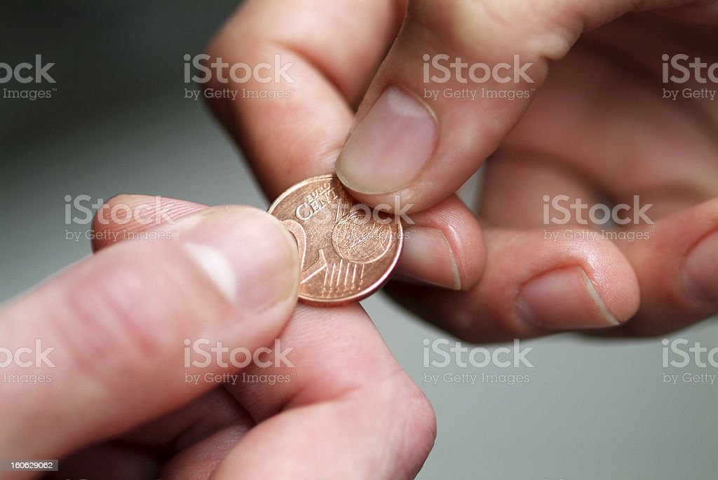 Hand giving 2 cents euro coin royalty-free stock photo