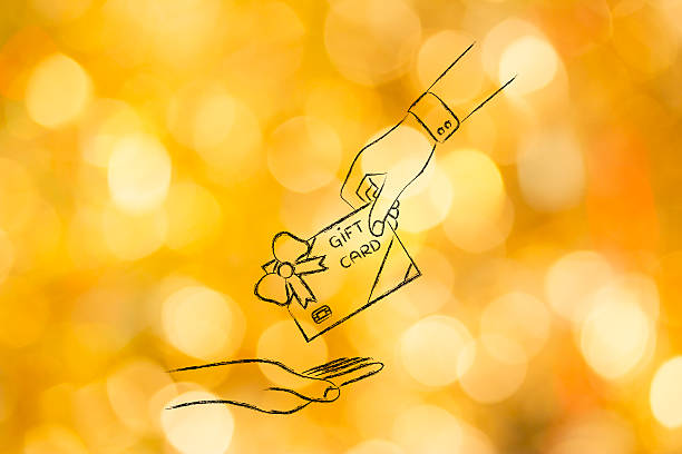 hand giving a gift card with wrapping bow stock photo