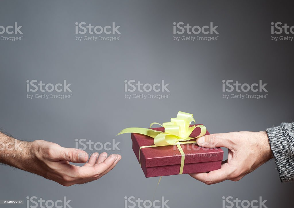 Male hand holding a gift