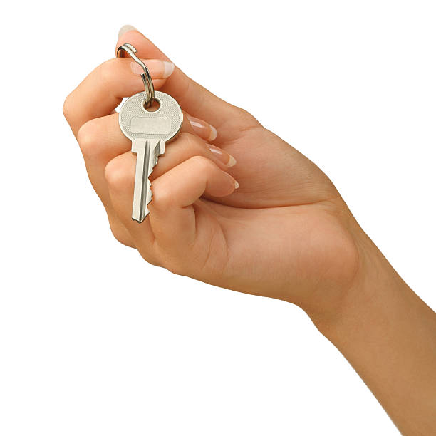Hand giving a key stock photo