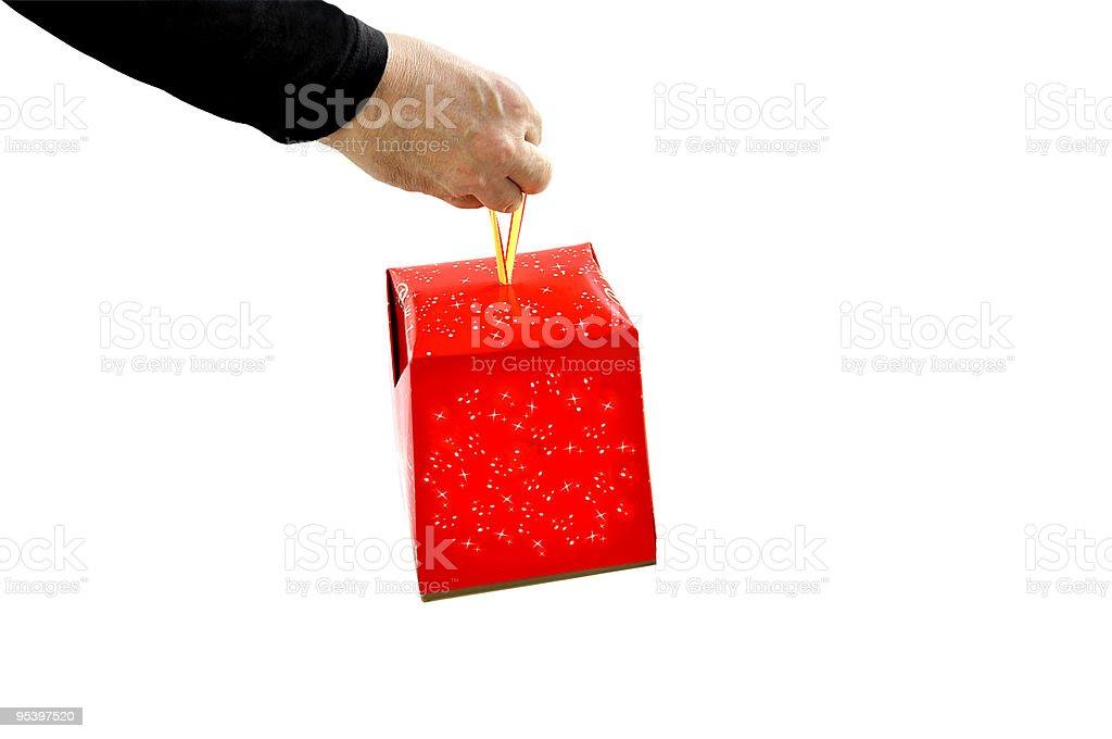 Hand geben ein Geschenk. Lizenzfreies stock-foto