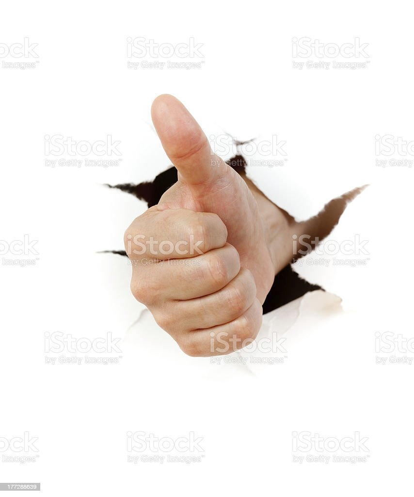 Hand giving a thumbs up bursting through a white background royalty-free stock photo
