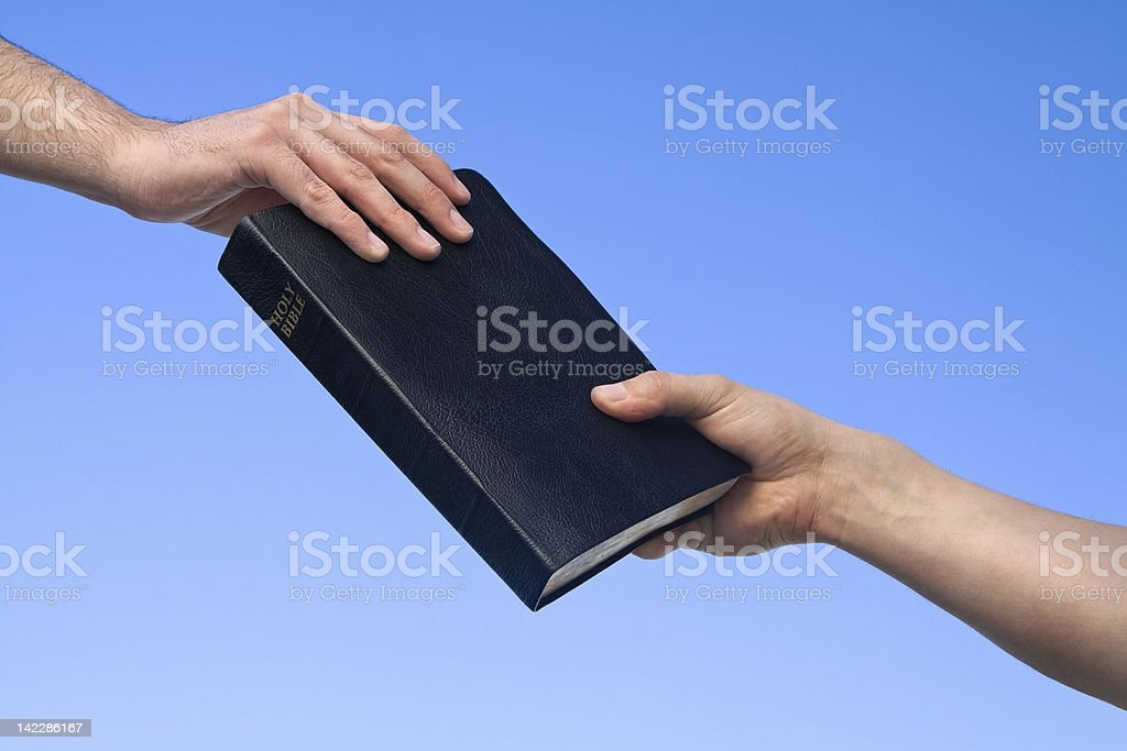 Hand Giving Bible stock photo