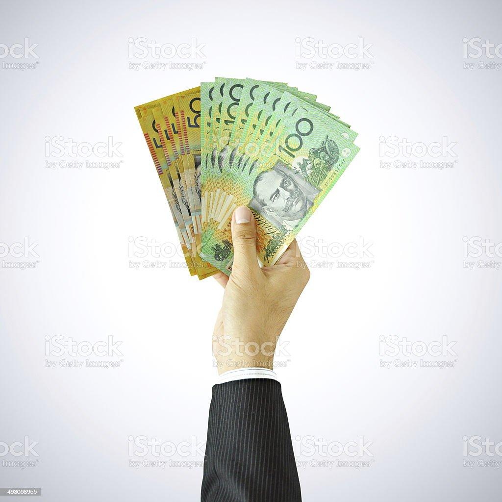 Hand giving money - AUD - Australian Dollars stock photo