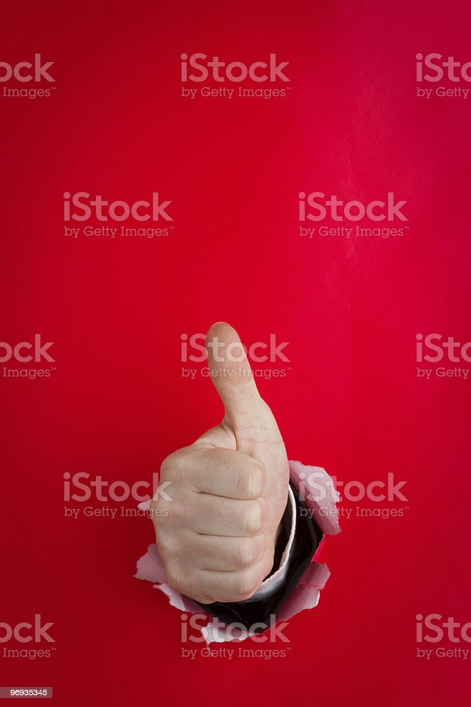 Hand giving thumbs up on red royalty-free stock photo