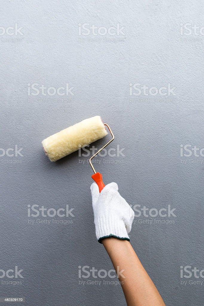 hand glove holding paint brush stock photo