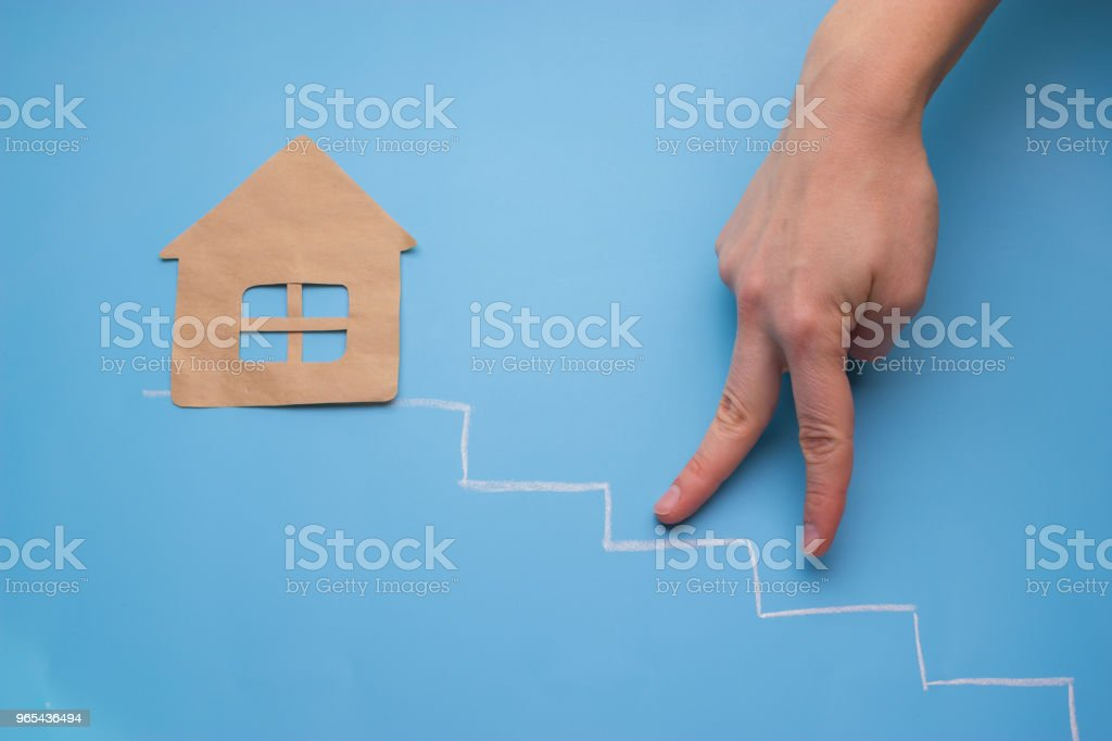 hand go up toward house royalty-free stock photo