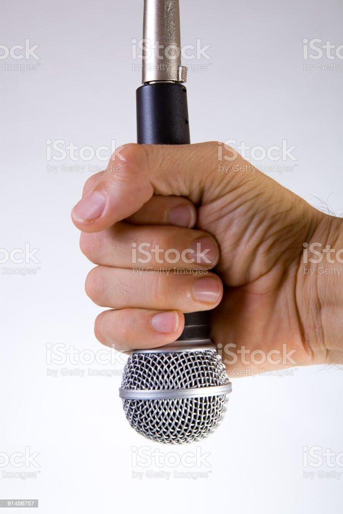 Hand Grabbing Microphone royalty-free stock photo