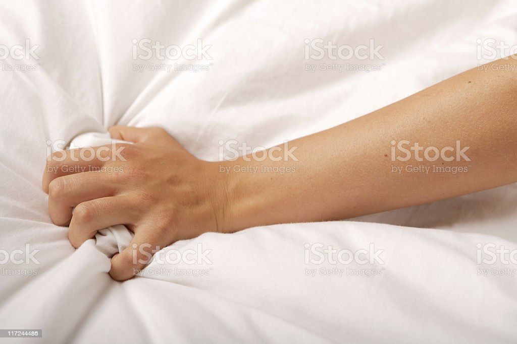 Hand grabbing sheet stock photo