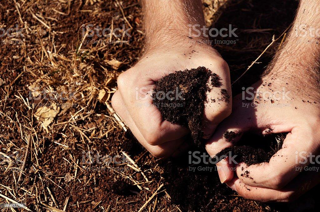 hand greife Ein angenehmes Fleckchen Erde – Foto