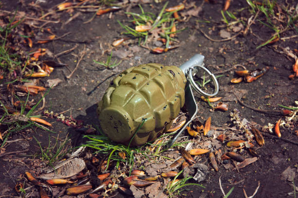 hand grenade grenade lying on the ground stock photo