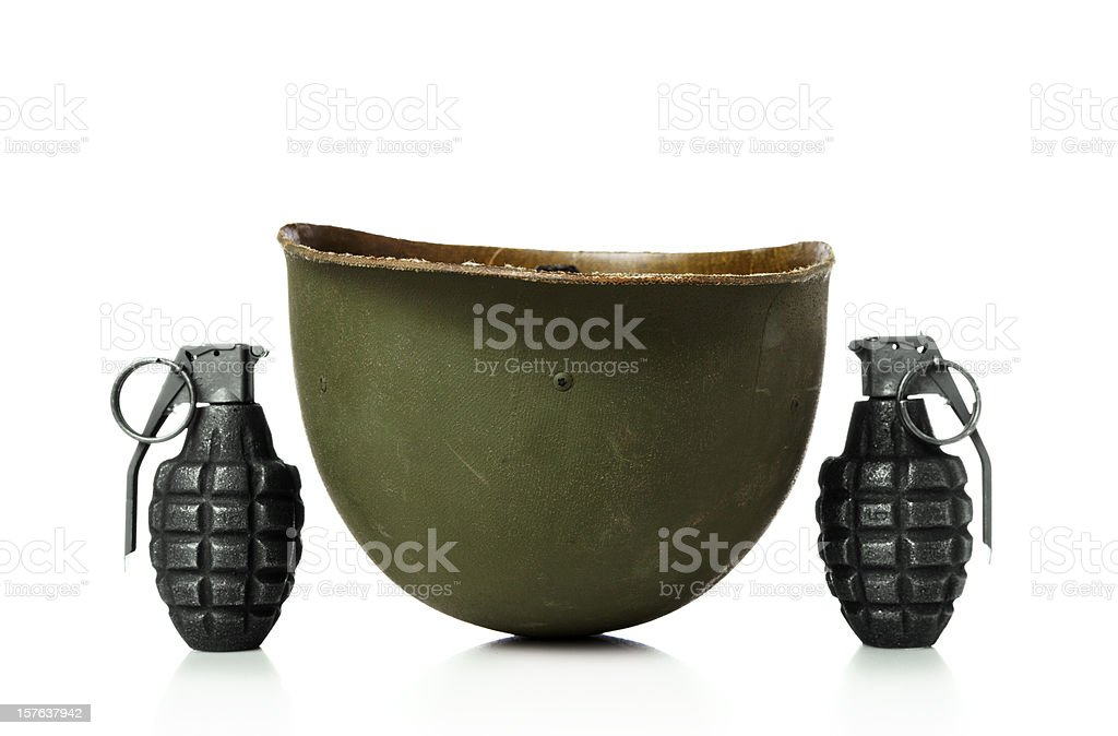 Hand grenades and army helmet stock photo
