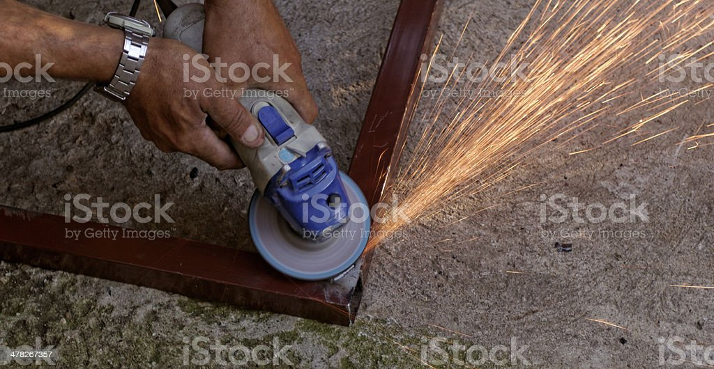 hand grinder buffing the steel royalty-free stock photo