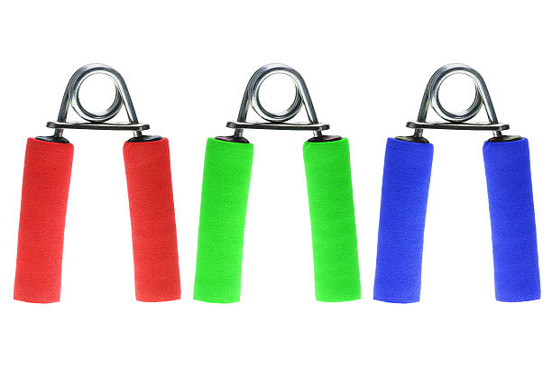 hand grip exerciser isolated on white - hand grip stock photos and pictures