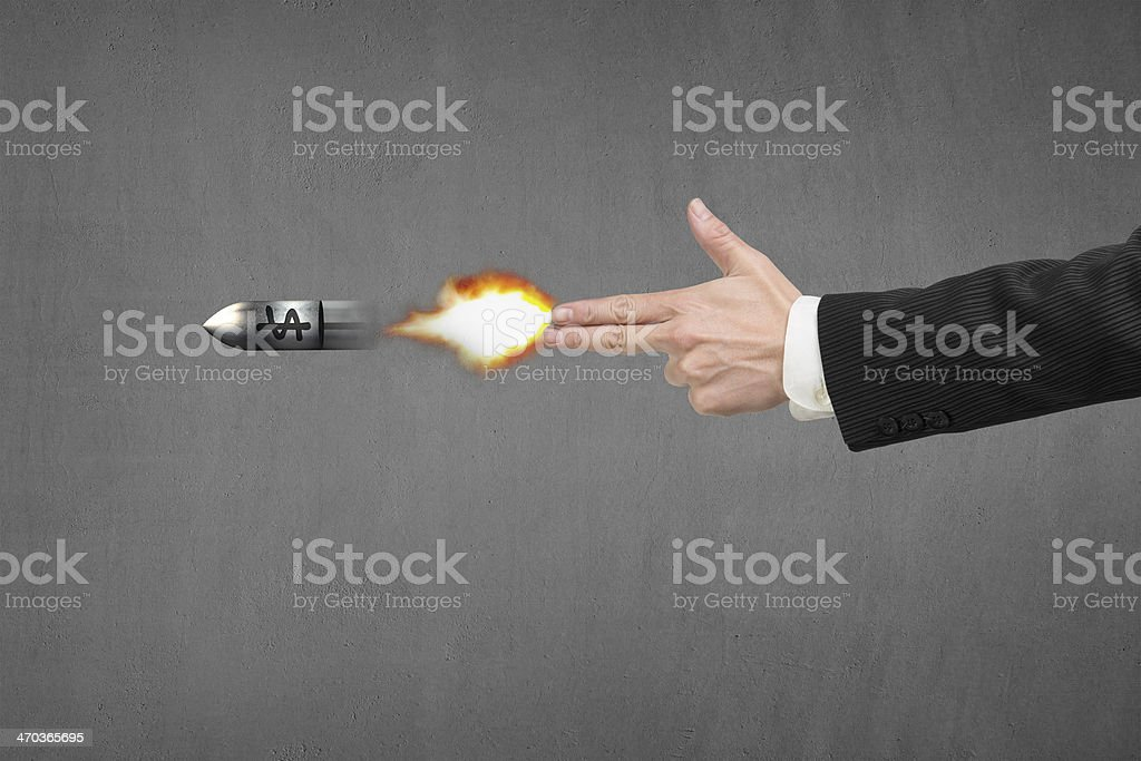 Hand gun gesture with fire, bullet and money symbol stock photo