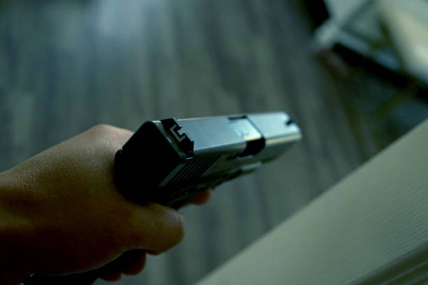 hand gun close up shot of hand gun shooting a weapon stock pictures, royalty-free photos & images