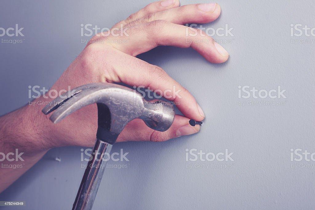 Hand hamering stock photo